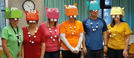 Staff dressed as characters from the game Hungry Hippos