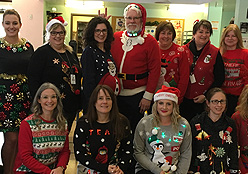 Staff wearing holiday sweaters