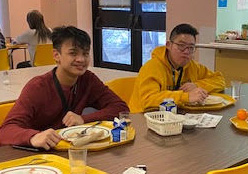 Students enjoying pancakes during breakfast