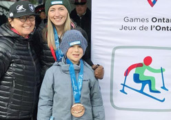 Hayden with coaches and guide, Anneliese Surmann